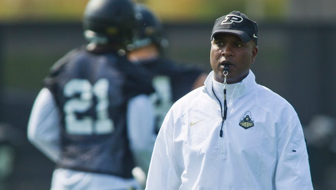 Purdue University football coach Darrell Hazell watches his team during the first day of practice.