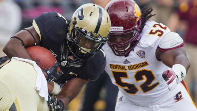 Purdue's Akeem Hunt gets hits by Central Michigan's Jabari Dean  during an NCAA college football game Saturday, Sept.  6, 2014, at Ross-Ade Stadium in West Lafayette. Purdue lost 38-17. (AP Photo/Journal & Courier, Michael Heinz)