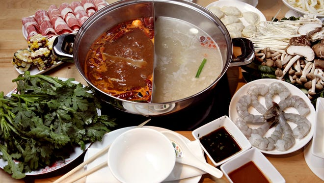 Hot pot dining is the Chinese version of fondue. Meats and vegetables are dipped in a hot broth to cook, then in a sauce for flavor.