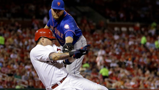 The Cardinals' Yadier Molina is tagged out by Mets first baseman Lucas Duda to end the seventh inning Monday.