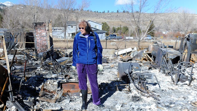Jeannie Watts stands where her house was before it was destroyed by the Washoe Fire on Jan. 19, 2012. Her mother, who lived next door to her, died in the fire.