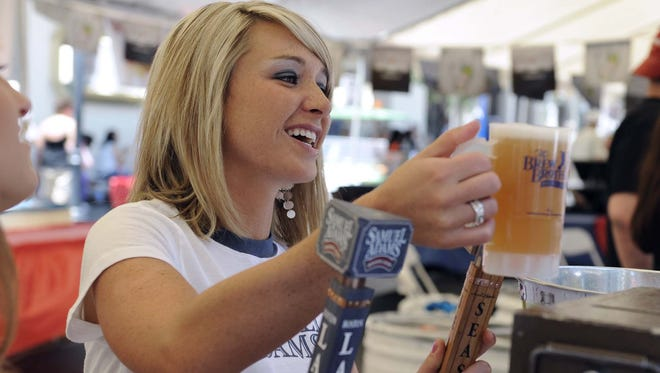 Taylor Scott works a beer booth at a past Eldorado BBQ, Brews & Blues Fest in downtown Reno.