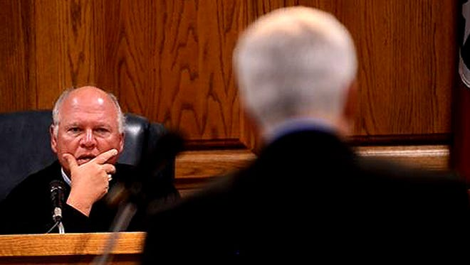 Judge Don Ash (left) listens to prosecutor Al Earls (right) at the appeal hearing for David Lynn Jordan, who was convicted of three counts of murder and sentenced to death in the 2005 shooting at the TDOT office in Jackson. The appeal hearing was held in Madison County Circuit Court on Friday. Jordan waived his right to appear in court.