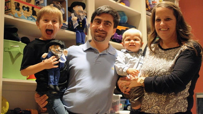 The Hoffmans, parents Neal and Erin with their two sons, Jacob, left, and Alex. The Madeira, Ohio, family trademarked Mensch on a Bench, which is Hanukkah's take on the popular Elf on a Shelf.