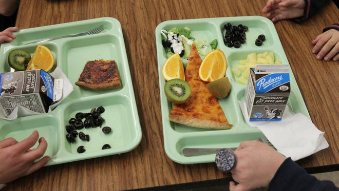 School workers at a Utah elementary school took lunches from kids that owed money.