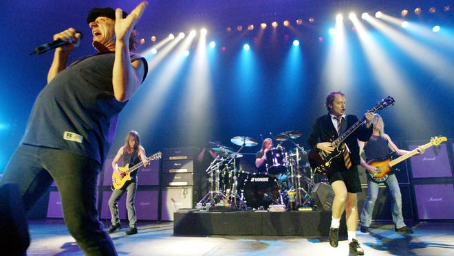 AC/DC --  Brian Johnson, left, Malcolm Young, Phil Rudd, Angus Young and Cliff Williams --  perform in 2003.