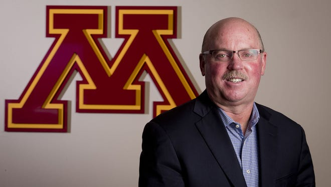 Minnesota Gophers head football coach Jerry Kill is back coaching while dealing with epilepsy, although he has yet to return to the sideline. He is working from the upstairs coaches booth.