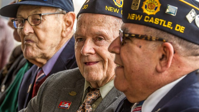 Stanley Lawruk (center), a WWII veteran, served in the Army Air Force as a navigator and machine gunner  on a B-17 during the Liberation of France. He flew three missions on D-Day and was shot down on his 24th mission.