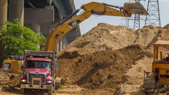 Removal of the 55,000-ton dirt pile was expected to be completed Monday.
