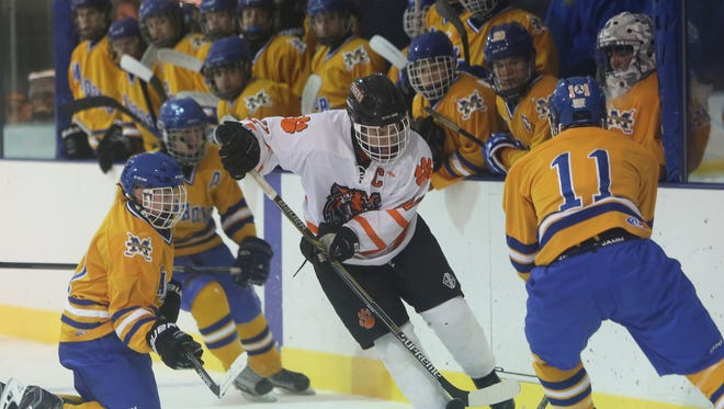 Frank Becerra Jr./The Journal News White Plains? Brendan McDonough controls the puck in front of the Mahopac bench during the Tigers? 4-2 victory over the Indians at Ebersole Ice Rink in White Plains Thursday. White Plains improved to 5-6-1 after an 0-5 start. White Plains' Brendan McDonough (27) controls the puck in front of the Mahopac bench during a hockey game at Ebersole Ice Rink in White Plains Jan. 14, 2016. White Plains won the game 4-2.
