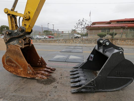 Crews work on relocating a water pipe along Stanton