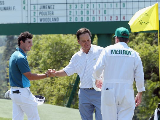 Rory McIlroy shakes hands with Jeff Knox on the 18th green during the third round of the 2014 Masters Tournament at Augusta National Golf Club.