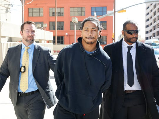 Former New Mexico State University football player Terrance Yelder, center, is led into the El Paso County Jail in January 2017. He is one seven people indicted by a federal grand jury in connection with a $237,000 bank fraud scheme.