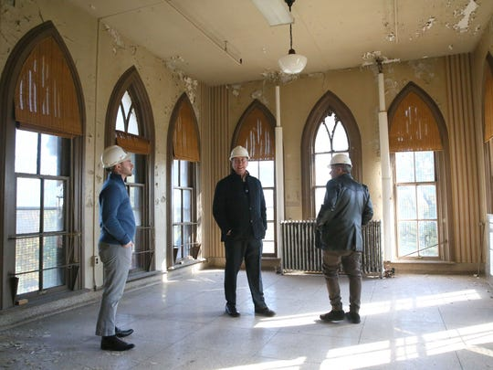 Peter Zanghi (from left) of the Milwaukee Preservation Alliance, Jonathan Beck, a development project manager from Alexander Company, and Jim Duff, Milwaukee County veterans service officer, look over some of the space on the second floor of Old Main.
