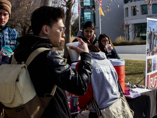 Zak Covert, 24, enjoys a fresh cup of coffee for free provided by the Reformed University Fellowship Campus Ministries group in welcoming back New Mexico State University  students on Wednesday, Jan. 17,2018