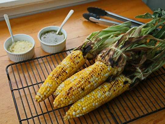 Make grilled corn more interesting by serving it with toppings, such as pesto and Parmesan cheese.