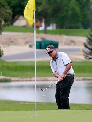Ryan Dillon chips on the 13th hole during the second round of the San Juan Open on Friday at the San Juan Country Club in Farmington.