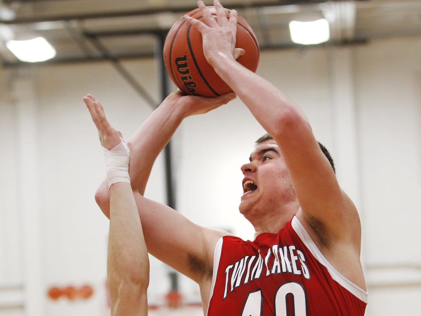 Dane Holmes of Twin Lakes scores over West Lafayette's Bradley Bittles.