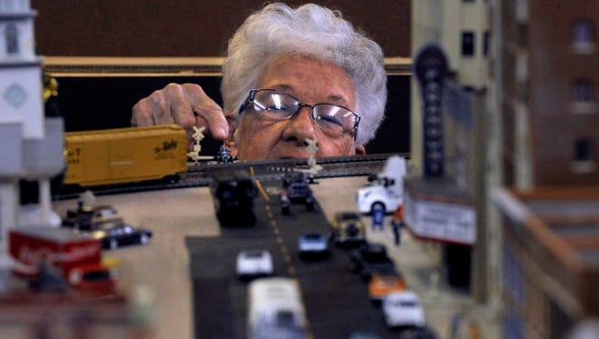 "Etta Adkins of Clyde notes a small figure placed at the crossing of the train line Saturday at open house for the Abilene Society of Model Railroaders new location. ""I was looking at a tiny, tiny motorcycle at the crossroads. I thought it was so clever, it was so small,"" she said."