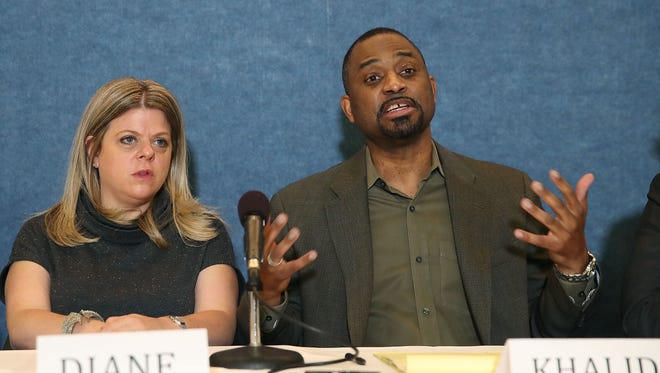 Restaurant owners Khalid Pitts and Diane Gross speak during a Thursday news conference about their lawsuit against President Trump.