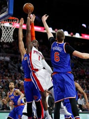Reggie Jackson dives to the basket against the Knicks