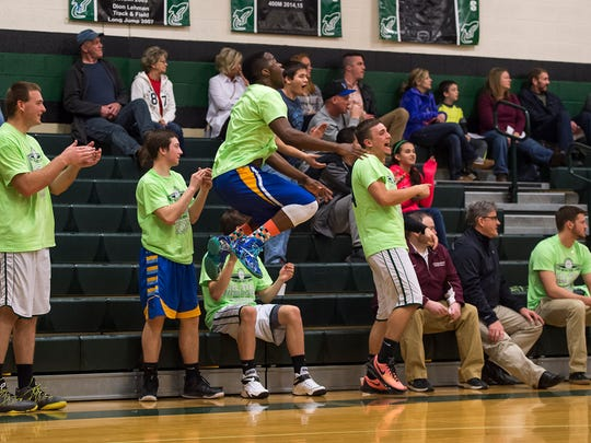The Green team cheers after Wade Mills scores a basket during the Blue Mountain All-Star Classic at James Buchanan High School in Mercersburg, Pa. on Saturday, March 19, 2016.