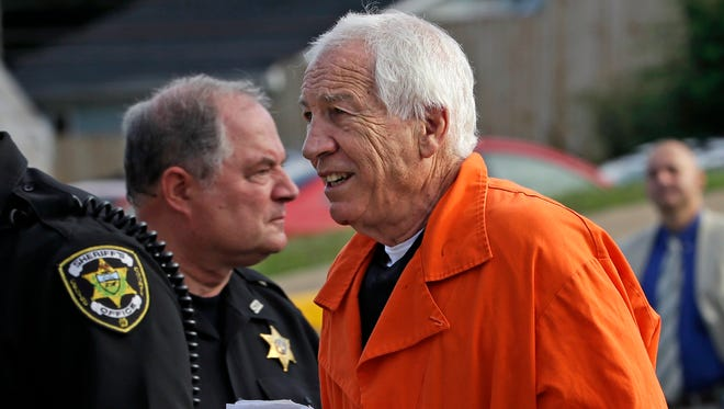 Former Penn State University assistant football coach Jerry Sandusky, right, arrives at the Centre County Courthouse for an appeals hearing about whether he was improperly convicted four years ago, in Bellefonte, Pennsylvania Friday.