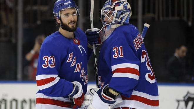 Rangers goaltender Igor Shesterkin (31) celebrates with left wing Phillip DiGiuseppe (33) after a 4-1 win over the Kings