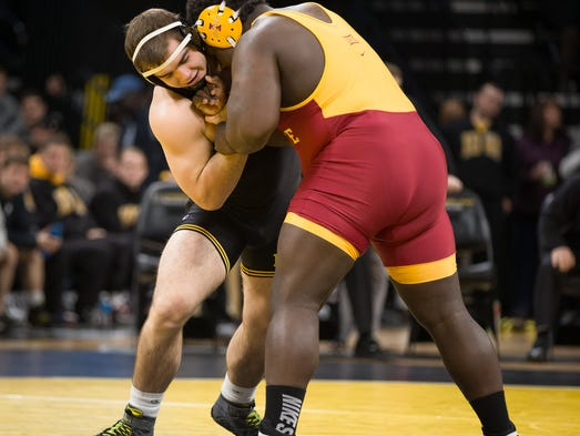 Iowa's Steven Holloway grapples with Iowa State's Quean