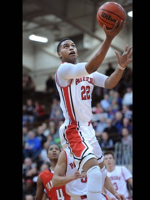 Trevon Bluiett of Park Tudor scores over the North Central defense. Park Tudor met North Central in a Marion County Tournament match up at Southport High School Friday January 17, 2014.