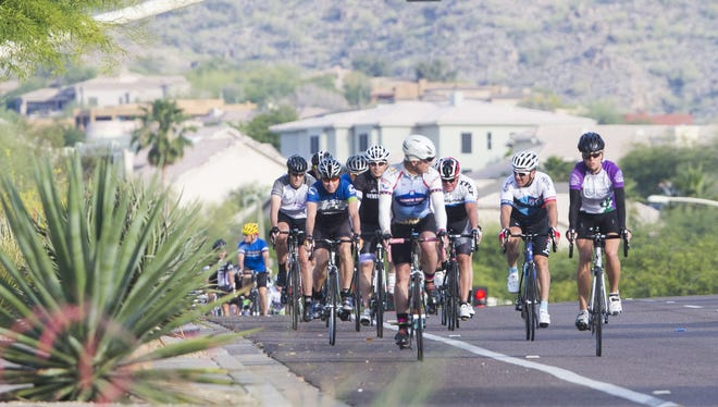 Jennifer Swanton (far right) leads a Team in Training ride through Fountain Hills on May 17. The bicyclists are headed to Lake Tahoe June 7 for a 100-mile ride to raise funds for the Leukemia and Lymphoma Society.