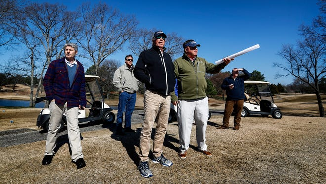 Professional golfer Curtis Strange, middle, consulting on improvements to Colonial Country Club's South Course, looks over the 2nd hole green Friday morning.