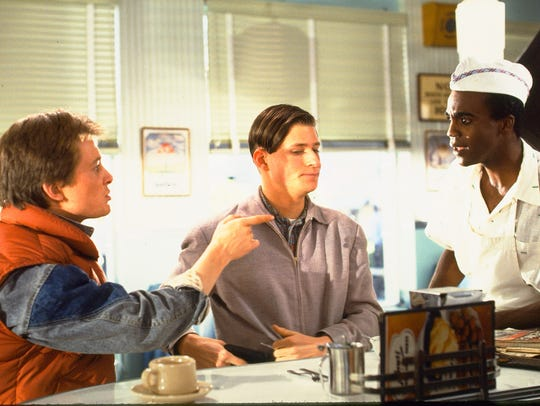 Michael J. Fox (left), Crispin Glover and Donald Fullilove
