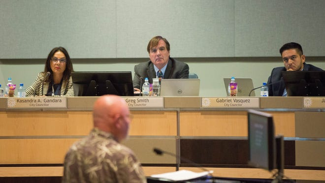 City Councilors Kasandra Gandara, left, Greg Smith, center, and Gabriel Vasquez, right, listen to Dan Parrott, during comment period for a resolution calling for safer schools during a city council meeting Monday June 18, 2018. The resolution mentions issues such as mental health, school building security and access to weapons. Many residents came out to support and oppose the resolution. Parrott said, while he supports making schools safer, is concerned the resolution would lead to the chipping away of the Second Amendment rights of lawful gun owners in Las Cruces,