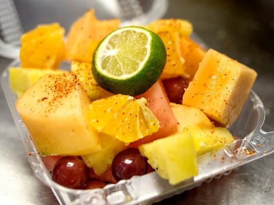Mexicone Sweets and Treats' Mexi Fruit Cocktail photographed on Friday, Sept. 15, 2017, in Lansing. Flores said the flavor is his most popular.