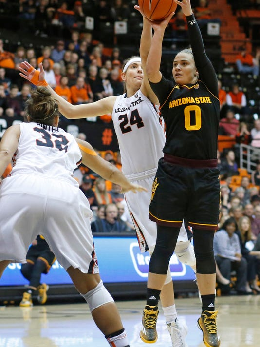 Oregon State's Sydney Wiese, center, tries to block the shot of Arizona State's Katie Hempen in the first half of an NCAA college basketball game in Corvallis, Ore., on Monday, Feb. 1, 2016. (AP Photo/Timothy J. Gonzalez)