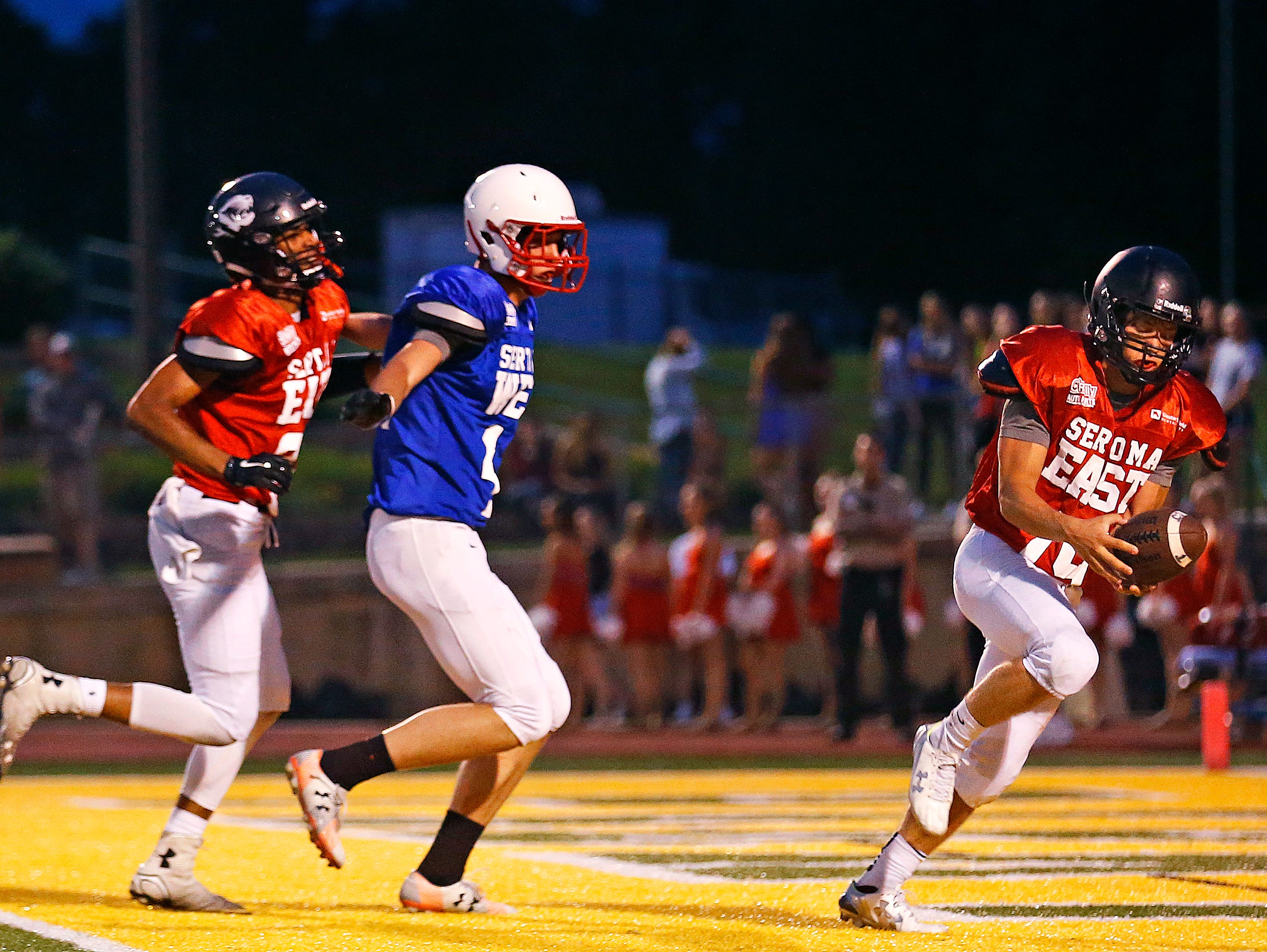 East All-Stars defensive back Conner Hicks (19) grabs his second interception of the night during second quarter action of the Sertoma Grin Iron Classic football game held at JFK Stadium in Springfield, Mo. on June 3, 2016.