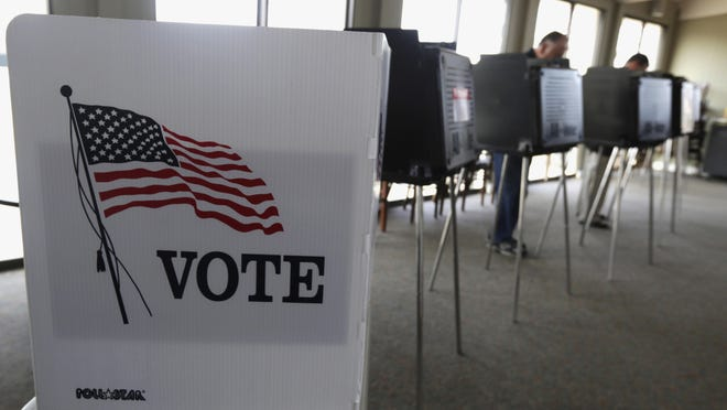 FILE - In this March 18, 2014 file photo, voters cast their ballots in Hinsdale, Ill. A new poll by the Associated Press-NORC Center for Public Affairs Research and MTV finds that most Americans ages 15 to 34 think voting in the midterm elections gives their generation some say about how the government runs, and 79 percent of this group say leaders from their generation would do a better job running the country. (AP Photo/M. Spencer Green, File)