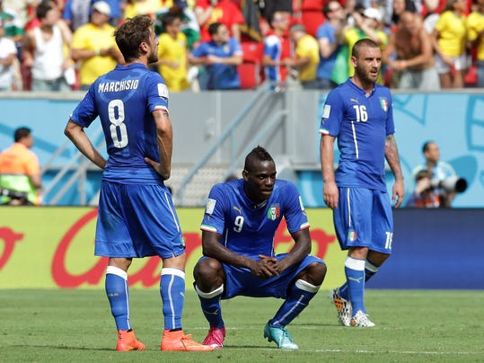 Italy's Mario Balotelli, center, and Italy's Claudio Marchisio react after Costa Rica's Bryan Ruiz scored the opening goal during the group D World Cup soccer match between Italy and Costa Rica at the Arena Pernambuco in Recife, Brazil, Friday, June 20, 2014.   (AP Photo/Antonio Calanni)