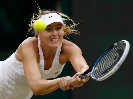 Maria Sharapova of Russia plays a return to Alison Riske of U.S. during their women's singles match at the All England Lawn Tennis Championships in Wimbledon, London, Saturday, June 28, 2014. (AP Photo/Ben Curtis)