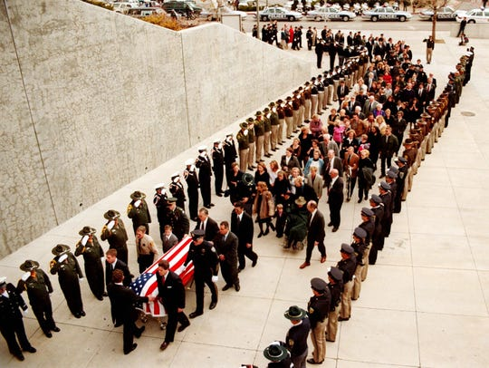 Officers from area law enforcement agencies salute