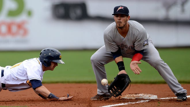 Stars first baseman Nick Ramirez takes a throw during Wednesday's game with the Biscuits.