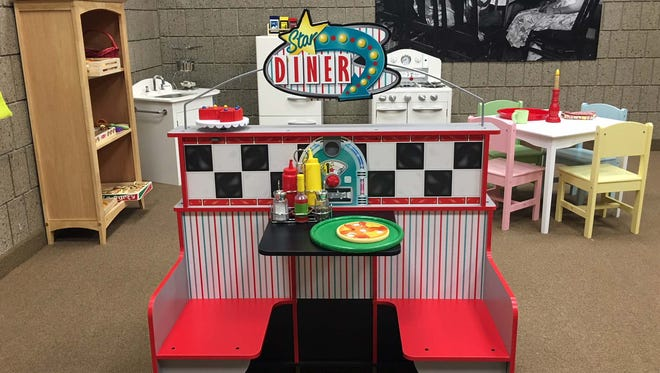 The children's space in the Stearns History Museum includes a 1950's diner, a produce store, a puppet theater and building blocks.