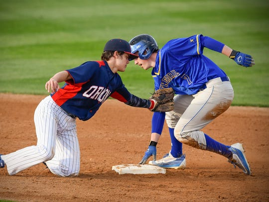 Cathedral's Jack Schramel, right, slides safely into