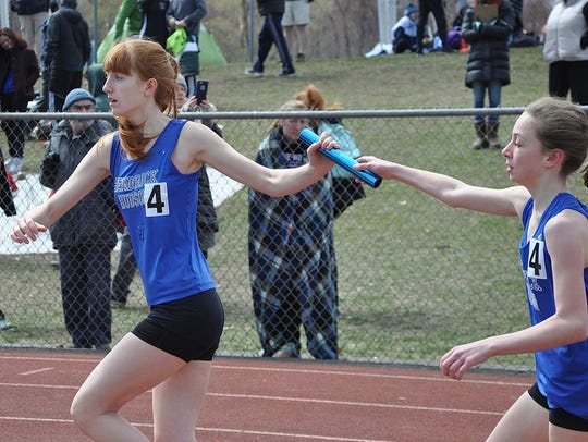 Hen Hud's Eve Kennedy (l) takes the baton from Leandra