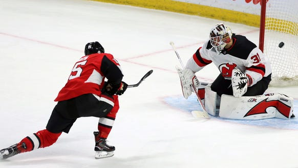 Ottawa Senators' Zack Smith (15) scores on New Jersey