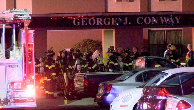 Firefighters are shown outside the George Conway Apartments in Brick late Friday, March 30, 2018, where a fire caused the evacuation of the building.