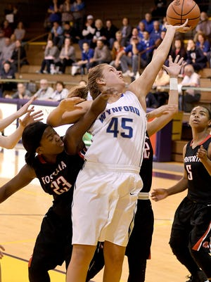 Wynford's Olivia Grove pulls down a rebound in the first half of game with Fostoria on Wednesday night at Lexington High School during the first round of the Division III Girls' Sectional Basketball Tournament.