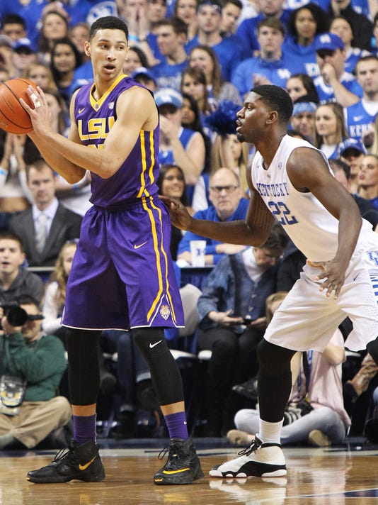 LSU's Ben Simmons, left, looks for an opening on Kentucky's Alex Poythress during the first half of an NCAA college basketball game Saturday, March 5, 2016, in Lexington, Ky. Kentucky won 94-77. (AP Photo/James Crisp)
