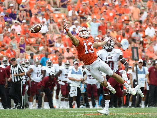 Clemson wide receiver Hunter Renfrow (13) reaches out for a pass as Troy safety Kyler Knudsen (40) defends during the second half an NCAA college football game on Saturday, Sept. 10, 2016, in Clemson, S.C. Something is off with the Tigers and they've got about a week and a half to get it right. (AP Photo/Rainier Ehrhardt)